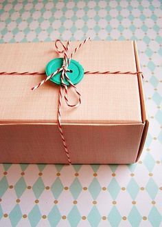 A button and baker's twine pair up for another other gift wrap idea. Wrapping Santa presents tonight!