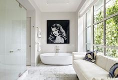 A Vik Muniz work depicting Rita Hayworth hangs in the master bath of a New York townhouse.