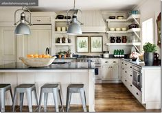 neutral kitchen with industrial elements designed by Jimmy Stanton of Stanton Home Furnishings in Atlanta lights, open shelves, floor, dream, hous, white cabinets, open shelving, stools, white kitchens