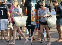 kate Moss has returned to dry land after spending some time on a yacht with Jamie. she's opting for a very nautical style. She teamed a striped top with her signature denim shorts and a giant straw bag, which no doubt contains her beach essentials. Copy Kate's look below for a Summer chic style and don't forget your wayfarers!