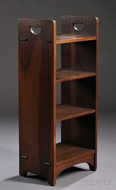 Gustav Stickley D-Handle Open Bookstand, oak wood, New York, 1904-1912, model 79 Four shelves, the top and bottom with through-tendon joints, over beveled feet with arched aprons, 40 H. x 16.5 W. x 12.13 D.
