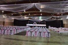 Beautiful banquet from one of our customers! White chair covers with black and pink sashes