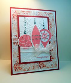 """Merry & Bright"" card made with:     - Deck The Halls stamp set by Beth Silaika for Gina K Designs  - Gina K. Designs Blizzard patterned paper  - Gina K. Designs Cherry Red card stock  - Gina K. Designs Pure Luxury white card stock  - White ribbon  - Clear gem stones  - Memento Lady Bug ink"