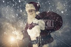 A real authentic Christmas photo of Santa Claus fighting a winter storm to deliver present to the kids Real Santa Pictures and This images can be licensed to use at realsantaimages.com | Do Not Use Without A License