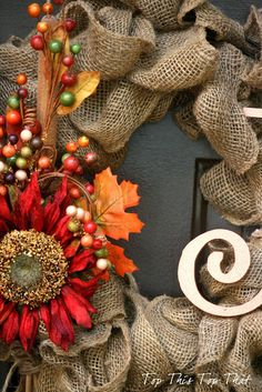 The Easiest Fall Burlap Wreath Tutorial - this is actually a year round wreath just by changing out the decorations on the wreath!