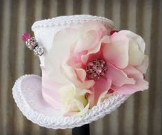 White and Pink Flower Explosion Easter Mini Top Hat, Flower girl, Tea Party Mini Top Hat, Mad Hatter Hat, Alice in Wonderland, Shower hat. $30.00, via Etsy.