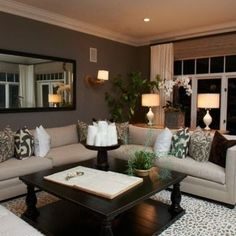 very pretty: colors, wall color, white accents, couch color and shape and mirror
