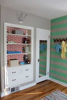 Baby boy nursery, turquoise/gray chevron accent wall, vintage baby clothes, neutral rug, built ins