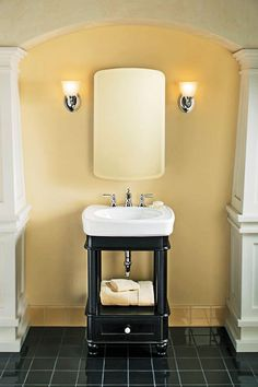 A black vanity and tile paired with neutral walls make a small bathroom feel elegant.