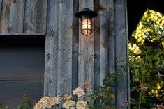 A couple covers exterior stucco with wood—genius