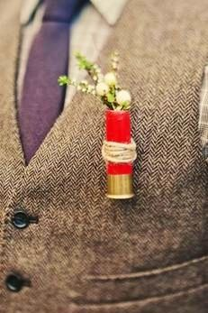 shotgun shell boutonniere. I would do different flowers but like the idea.