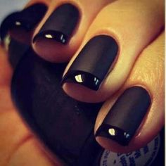 Fantastically dramatic nails, most often worn by the Water Element. Matte black with french tips.