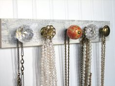 It seems like every old apartment is equipped with a cut-glass knob, typically on the bathroom door; they're usually loose, don't turn all the way, or the door never stays shut. But when it's time to replace them, don't let your landlord toss 'em away. They're the perfect decorative piece for your own handmade jewelery rack, like this one we found by Aunt Dedes Basement. Find simple DIY instructions on Silk & Cinnamon: http://silkandcinnamon.wordpress.com/2012/12/04/wood-jewelry-hanger-tutorial/
