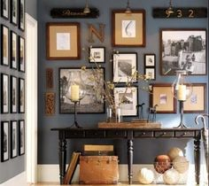 Gallery wall. Yummy wall colour, and some wooden carvings add interest to this gallery: