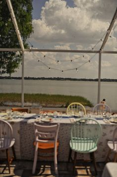 Painted chairs at a florida wedding.  Hope and Arthur's Wedding  Photo By Alyssa Maloof Photography