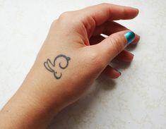 bunny tattoo @David Nilsson Nilsson Harris I like this one better :) But I'm still looking...