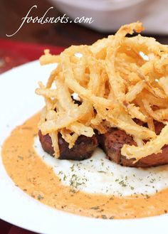 Filet Mignon with Roasted Red Pepper Cream Sauce, Mashed Potatoes, and Onion Strings