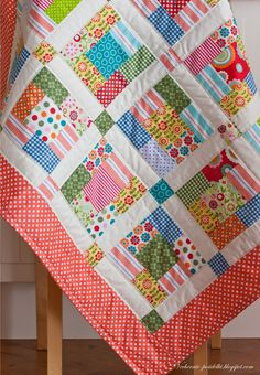 Lovely spring cot quilt - with old baby clothes??? maybe