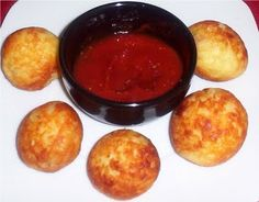 Cheese Puppies    1 1/2 cups grated cheese  1 egg  2 Tablespoons Carbquik  pinch salt  garlic, onion powder, flavoring of choice