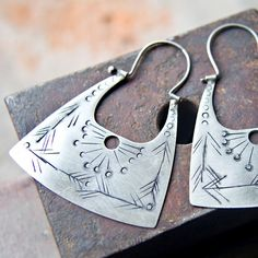 Gorgeously detailed silver earrings.