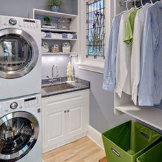 Contemporary laundry room by Crystal Kitchen Center.