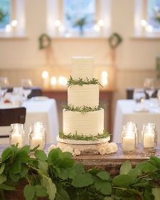 One of the bride's closest childhood friends, Sarah Bell of Bobbette & Belle, incorporated honey, an ingredient often used in Greek desserts, into the tiered wedding cake. She decorated it with rosemary sprigs.