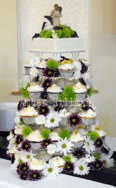 Wedding cupcake tower w/wildflowers.