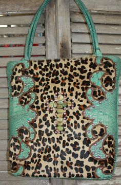 KurtMen Designs Large Leopard Hair on Hide with Turquoise and Brown Hand Tooled Leather with Large Turqouise Cross www.gugonline.com $479.95