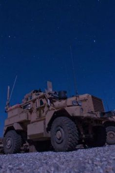 A mine resistant ambush protected vehicle belonging to a Task Force Maverick, 1st Cavalry Division explosive ordinance disposal unit sits in the glow of the full moon on Combat Outpost Red Hill.