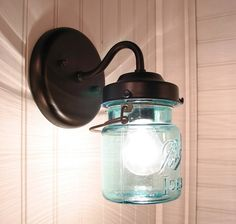 Who new you could do so much with a canning jar.  Vintage BLUE Canning Jar SCONCE Light by LampGoods on Etsy, $69.00