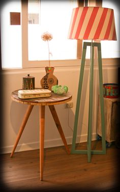Side table made with a cable reel, wood lamp