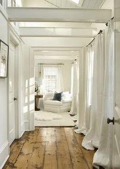 all white, long curtains, hardwood floors :)