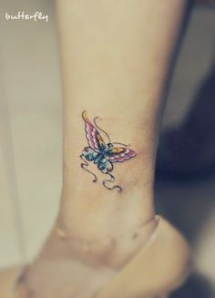 a pink and blue butterfly tattoo on the leg #butterfly #tattoo