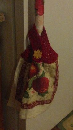 Crocheted dish towel topper.