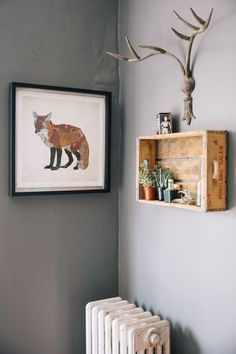 A little nook of rustic, outdoorsy character, including a foxy print, repurposed wood crate and some antlers. Via Rue mag.