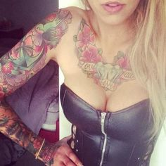 Female sleeve and chest tattoo