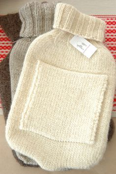 I Love hot water bottles! I even have one with a *MINK* cover! Marilla made me a cashmere cover from an old sweater too...Hot water bottles remind me of my mom & my nana...and childhood...comforting on cold nights or for tummy aches...