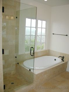 Seamless shower stall next to soaking tub