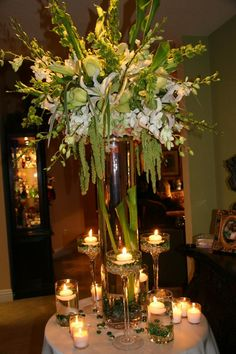 White Green reception wedding flowers,  wedding decor, wedding flower centerpiece, wedding flower arrangement, add pic source on comment and we will update it. www.myfloweraffair.com can create this beautiful wedding flower look.