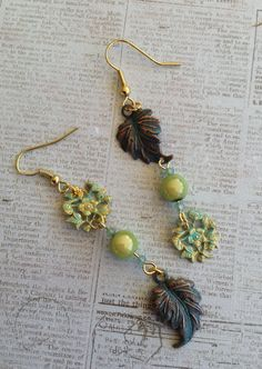 August Challenge Asymmetrical Earrings .. These sweet earrings are made using B'sue Leaves, Connectors, Spectra Beads .. also a few 3mm Crystals .. Perfect for Summer or Fall .. Designed by Jann Westlake Tague .. Clever Designs .. https://www.facebook.com/JewelsByJann