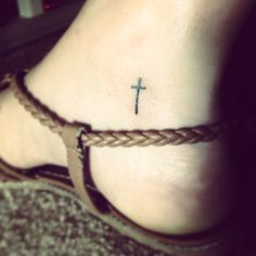 Small ankle tattoo of a cross