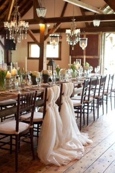 Elegant wedding table & tulle chair back decorations #candles #reception #décor #tulle  Photo: Pam Cooley on Snippet & Ink