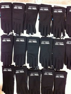 Rows of custom branded gloves for a client.  What project can we help you with today?  www.visualimp.com