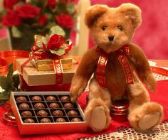 """Our Hugs and Kisses Teddy Bear is cute, plush, and cuddly! This little guy will warm the heart of the one you love, and the yummy truffles will deliver your sentiments of love and affection in good taste. Send our Hugs and Kisses Teddy Bear to him or to her to show how much you care.    14"""" Fuzzy Teddy Bear  8.5 oz Double Chocolate Truffles  4 pc. Mocha Chocolate Truffles     SHOP NOW: www.KimsLabellabaskets.com"""