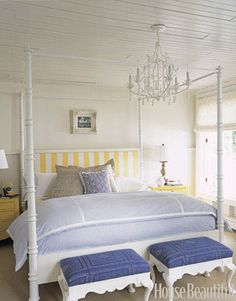 shades of blue with a great yellow striped headboard pop~