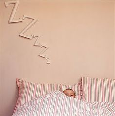 Something cute (wishful thinking?) for a baby's nursery.  It's a neutral DIY project but since the picture is of a pink wall I put it in my baby girl nursery decorating category.