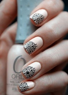 neutral base with an elegant black design on the tips of each nail.