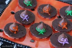 Witch Hat Cookies:  One of the easiest Halloween tricks (and treats!). Place a Hershey's Kiss on top of a Keebler Fudge Strip Cookie and you have a little hat. Use the little tubes of frosting you can buy in the grocery store baking isle. Pipe a ring around the outside of the bottom of the kiss and press onto the cookie. It will squeeze out and make the ring around the kiss. Then pipe on the bow.