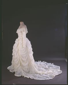 This wedding dress was made from a nylon parachute that saved Maj. Claude Hensinger during World War II.  In August 1944, Hensinger, a B-29 pilot, and his crew were returning from a bombing raid over Yowata, Japan, when their engine caught fire. The crew was forced to bail out. Suffering from only minor injuries, Hensinger used the parachute as a pillow and blanket as he waited to be rescued. He kept the parachute that had saved his life. He later proposed to his girlfriend Ruth in 1947, offe...