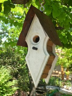 RUSTIC Utah Item # 33: Small diamond-shaped white and brown hanging birdhouse with rusty metal roof